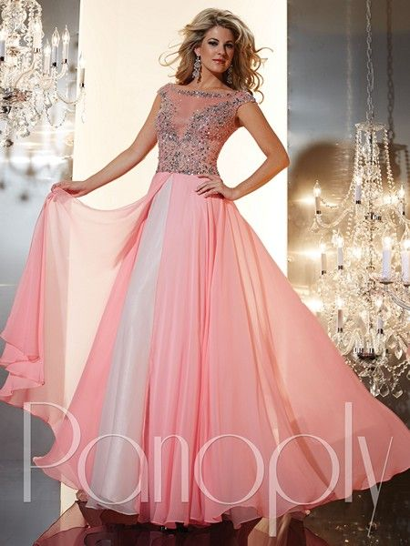 This Panoply 14637 Prom Dress was designed to bring out your inner princess. This lovely gown features a subtle boat neckline outlined in dazzling rhinestones and is draped in sheer fabric for flirty coverage. The fitted bodice is embellished with gorgeous jewels that add opulent shine to your overall look. Bold, yet graceful, the tulle ballgown skirt has an overlay of extravagant chiffon fabric, creating a very romantic look. This gown is sparkling in absolute luxury.
