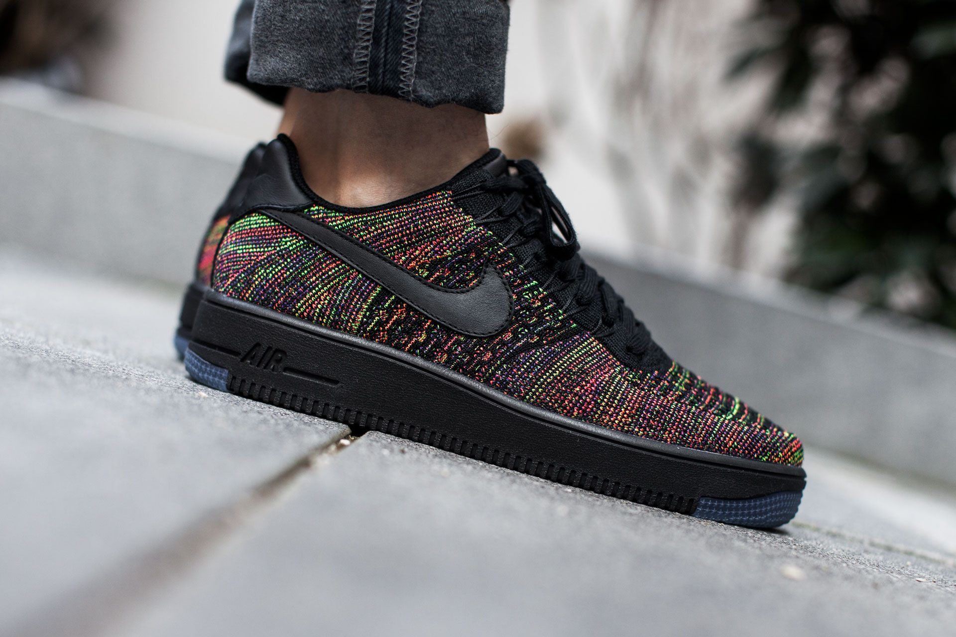 Nike Air Force 1 Flyknit Low 'Multicolor' available at: www.tint-footwear.com/air-force-1-flyknit-low-001 #Nike #AirForce #1 # Flyknit #Multicolor #dark #low #tintfootwearstudio