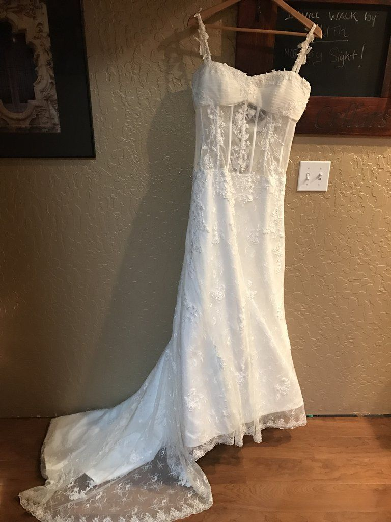 Beautiful Pnina Tornai replica dress. No blemishes or flaws. Gorgeous lace and beading detail. Lace applique on straps and bodice . Bodice is sheer with boning and a corset back. Size 8. I am 5'3 but wore heels so it was altered to about 5'6.