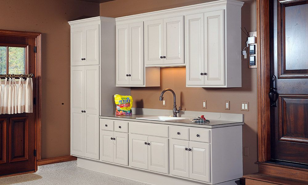 Even The Garage Can Benefit From Having White Cabinets White Cabinetry Home Cabinet