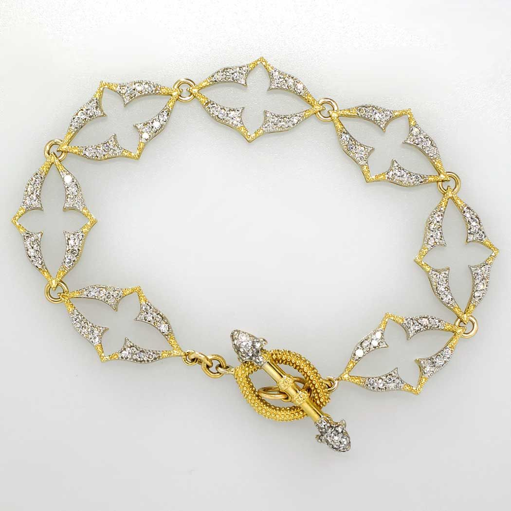 Elegant 1.05ct t.w. Glittering Quatrefoil Jude Frances Diamond Bracelet 18k | Antique & Estate Jewelry | Jewelry Finds Price: $3500.00  A subtle elegant Jude Frances designer estate bracelet for over $3000.00 off the original retail price. What a find! I almost kept it for myself for the stunning diamond frosted two tone look and ornate design! Not to mention the solid 18k gold and pave encrusted toggle! Just a timeless estate bracelet for the woman who wants something to wear with…