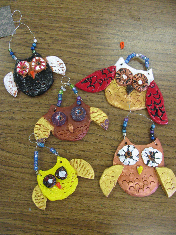 2nd grade ceramic owl relief sculptures; art teacher: Susan Joe