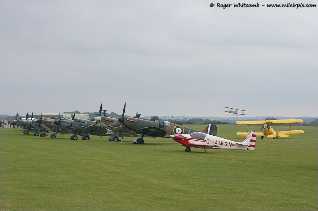 Lineup of Supermarine Spitfires together with Fournier RF4D, G-AWGN and with De Havilland DH.82A Tiger Moths DF112 & R4922 in the background