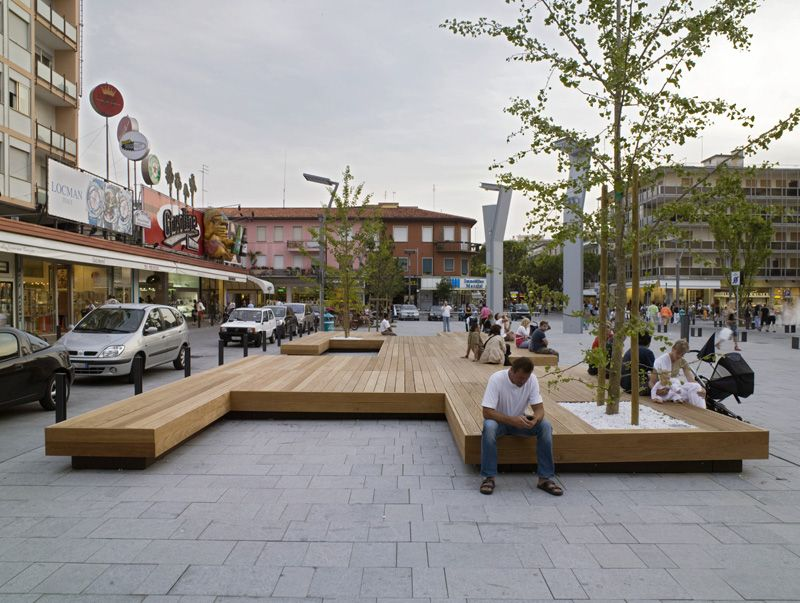A Large Bench Serves As A Gathering Place In This Town