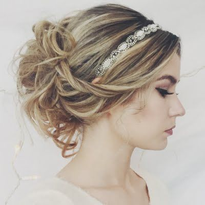 This hairstyle features brilliantly blonde-colored hair, curled and set into a romantic updo. Get this formal hairdo using these products available at Beauty Brands.