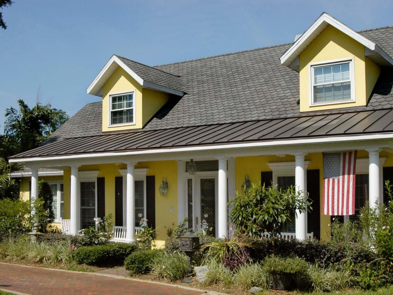 this bright yellow home exterior pops against the white molding