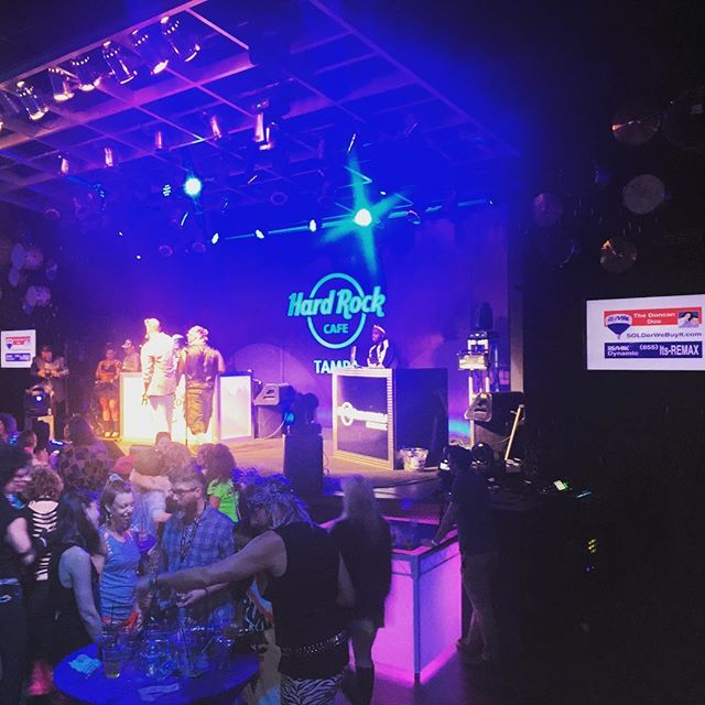 Pretty cool seeing our sign next to the stage at the #seminole #hardrock during Ian Beckles 80s party and the performance by Rob Base!  #620wdae @620wdae #partyoftheyear #sofar #tamparealestate #besttamparealtors #remax #theduncanduo
