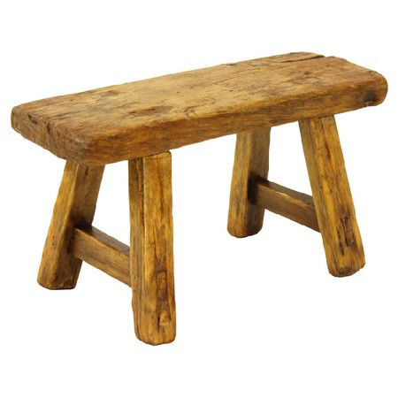 handmade wood stool with distressed detailing and a rustic finish