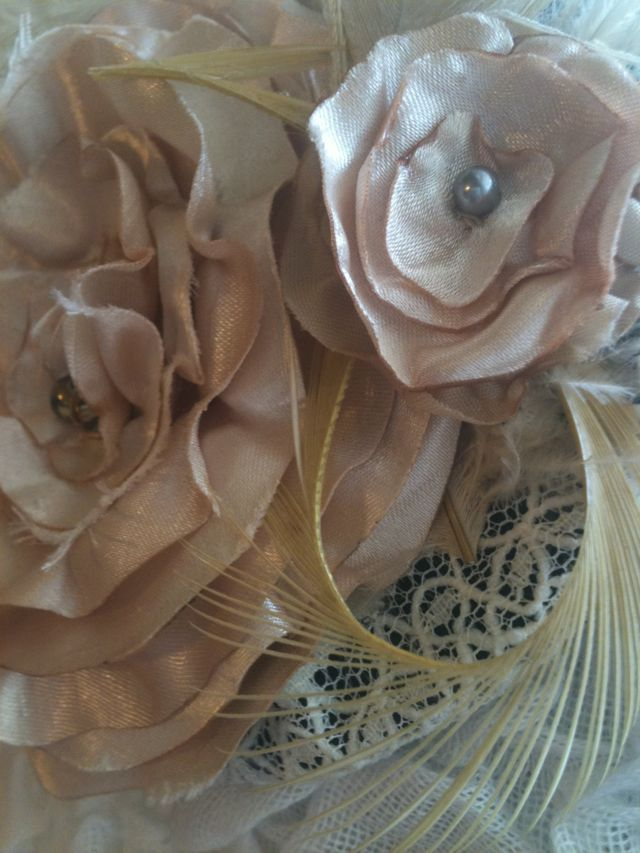 Dark Ivory Flower and Feather Fascinator Comb or Clip. $28.00, via Etsy.