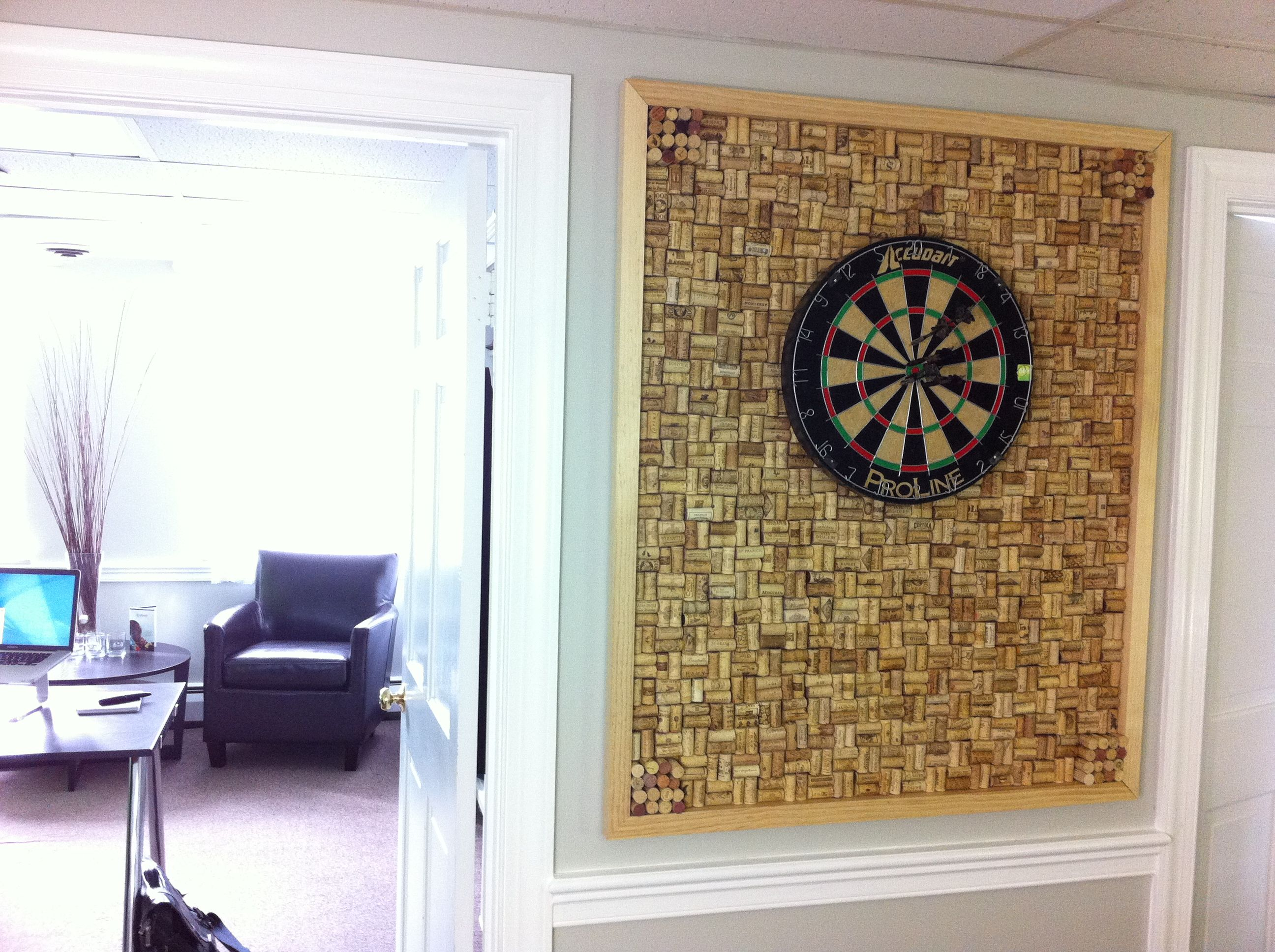 custom dart board frame with wine cork backing located in our design studio for brainstorming