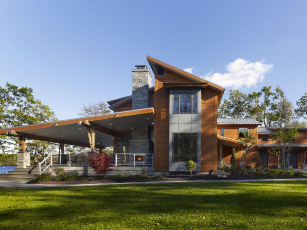 fachada de casa de campo ampla e moderna com lareira