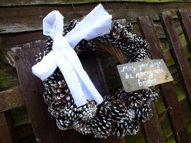 Snowy pine cone wreath £15.00