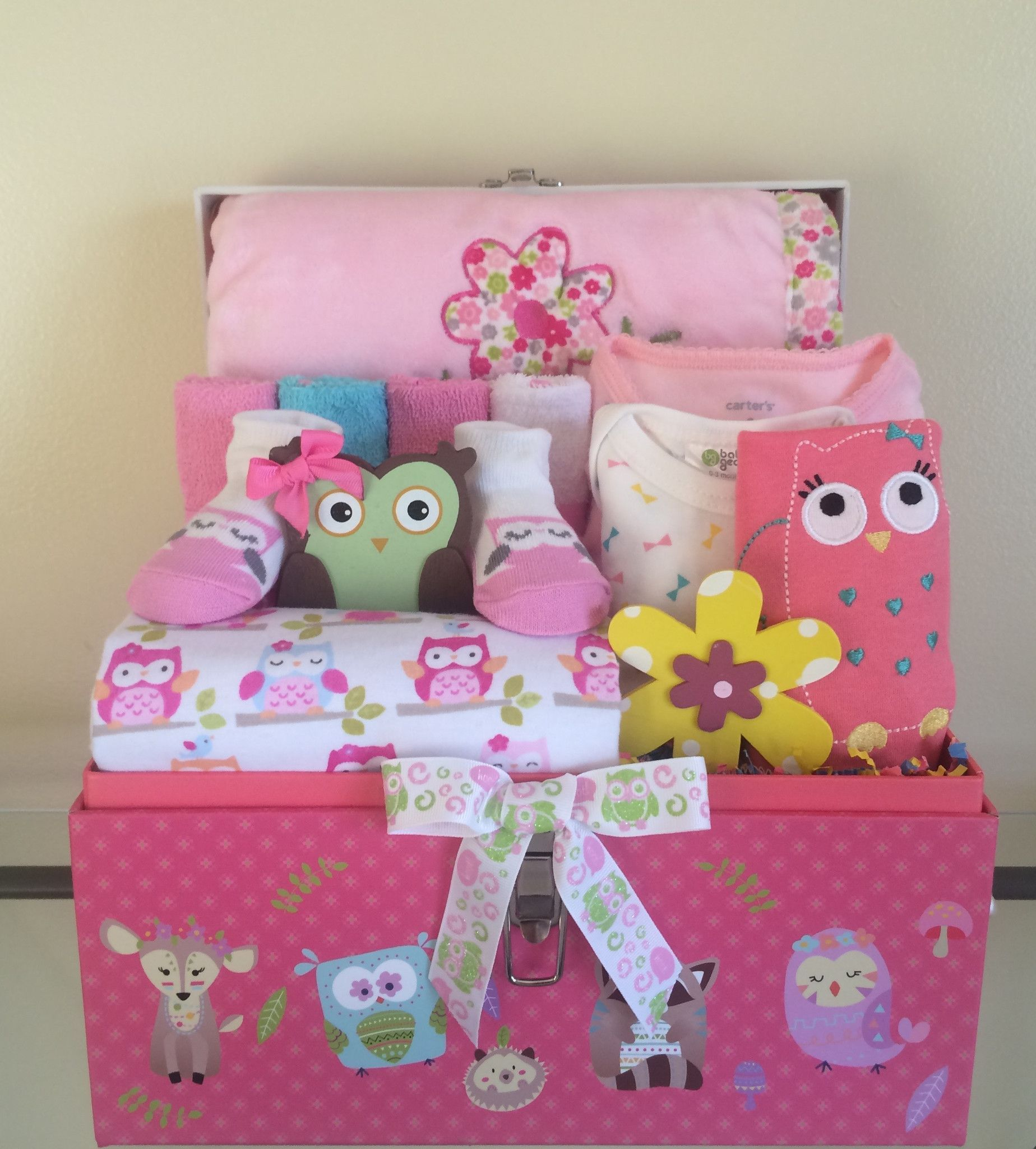 """This cute pink elephant and jungle friends gift basket includes: 34 size 1 Huggies diapers in base of basket, 1 receiving blanket, soft plush large pink/white zebra print blanket with matching zebra """""""