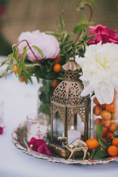 Moroccan inspired tablesetting with a gold latern and cute little gold camel | Party Social Blog & Moroccan inspired tablesetting with a gold latern and cute little ...
