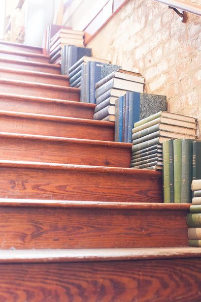 Love this! Stacks of books line the staircase of The Paris Market in Savannah, Georgia