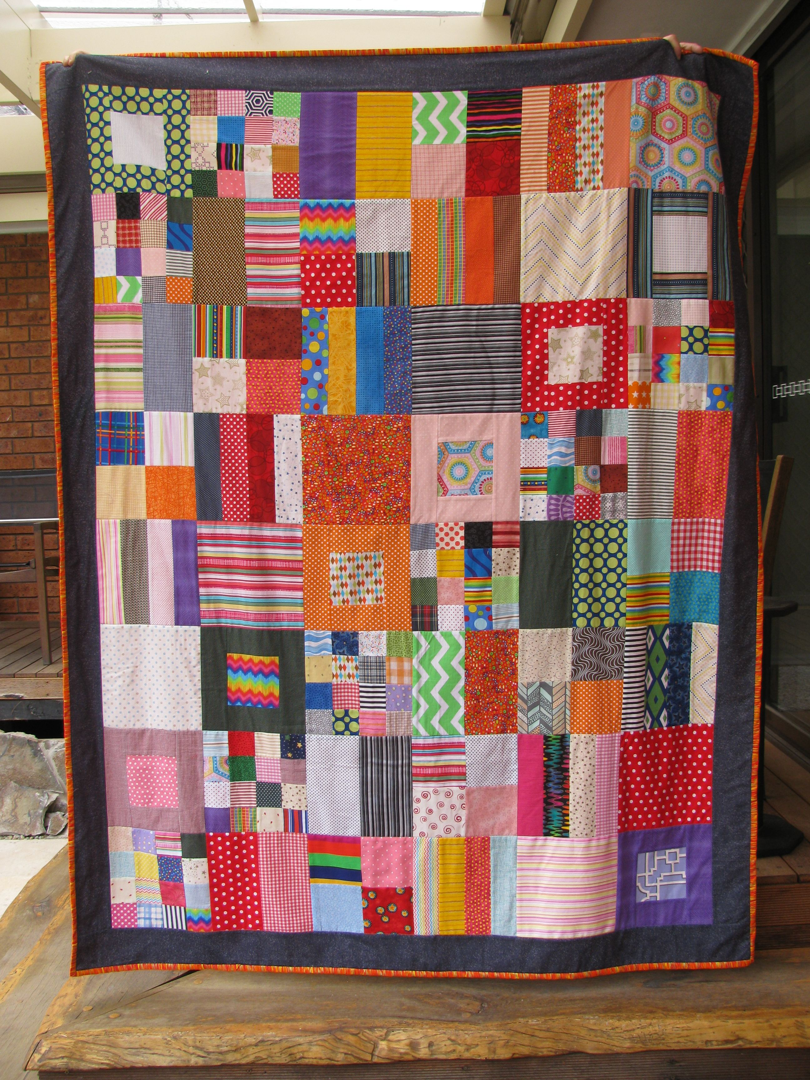 Geometric scrap quilt - stripes and dots and everything in between.