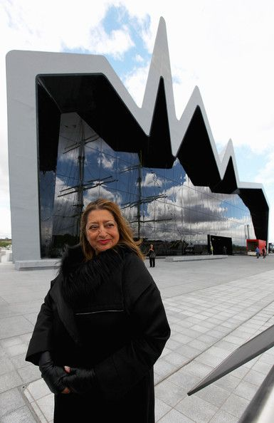 Architect Zaha Hadid standing in front of one of her designs, the Riverside Museum in Glasgow. Iraqi-British Hadid was the first woman to win the Pritzker Prize for Architecture.