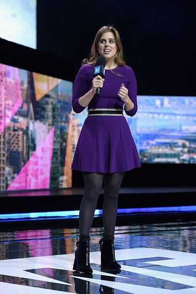 Princess Beatrice chose to wear a bold purple mini dress with a studded belt, black tights and Zara velvet ankle wrap zip front boots. As she speaks on stage at the inaugural WE Day at Radio City Music Hall on April, 6, 2017 in New York City.