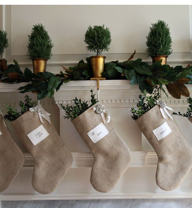 burlap stockings + greenery on the ledge between kitchen and