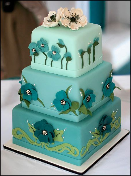 Turquoise ombre wedding cake with teal poppies
