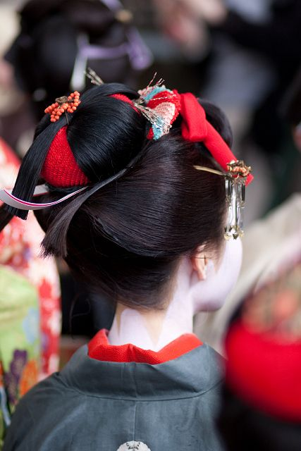 Comb Festival. This young woman is probably a maiko.