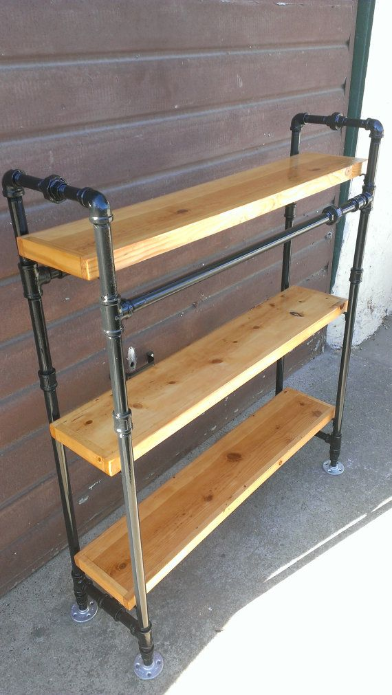 bookcase made with steel pipe frame and solid wood shelves