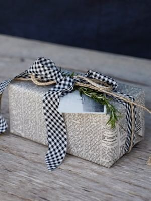 Newspaper, string, tape, a sprig of rosemary and an old black and white photograph. Masculine gift wrap