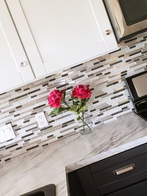 mosaic glass tile backsplash with metal in it white and gray marble