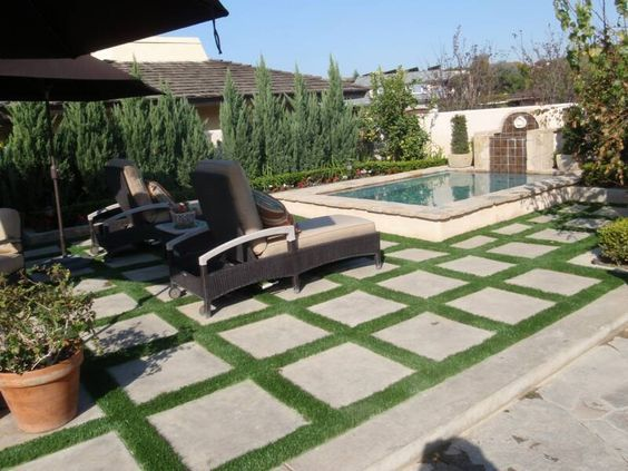 That Is Artificial Grass Between The Pavers Pool