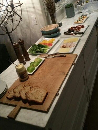 BLT Bar with outrageous local bread, avocado, heirloom tomatoes, various cheeses, turkey, lettuce. Served with caprese salad with mozerella de bufula