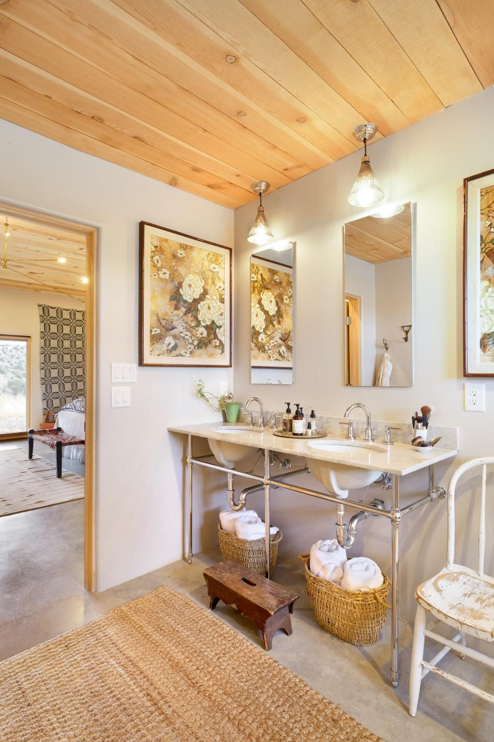 This neutral master bathroom features a double sink vanity with