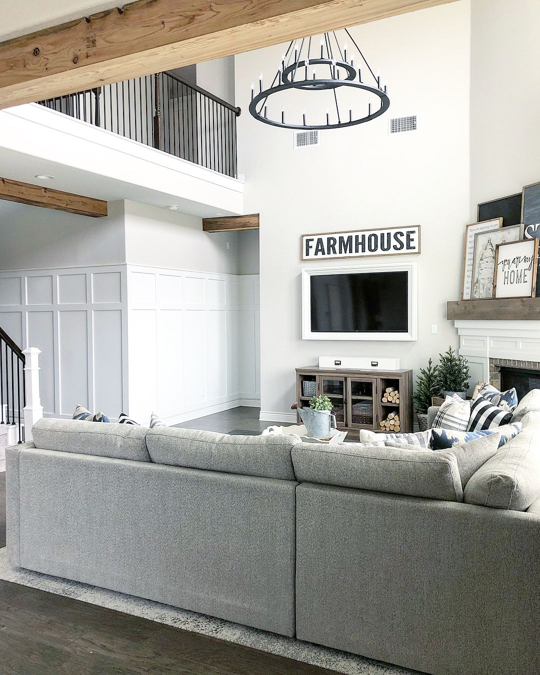 Love the framed out tv! holly our faux farmhouse
