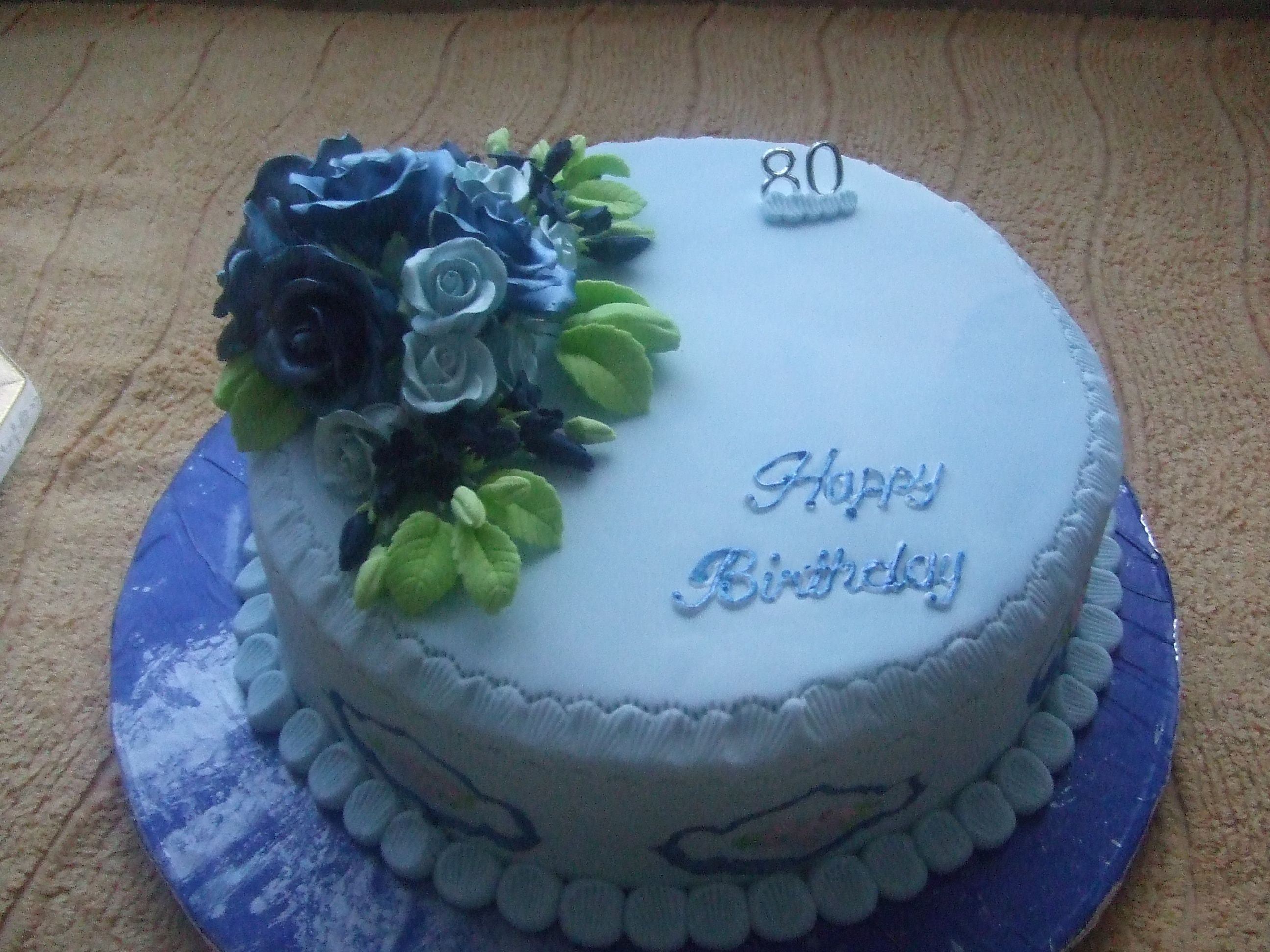 Ladys 80th birthday cake done in Baby Blue with royal blue and baby