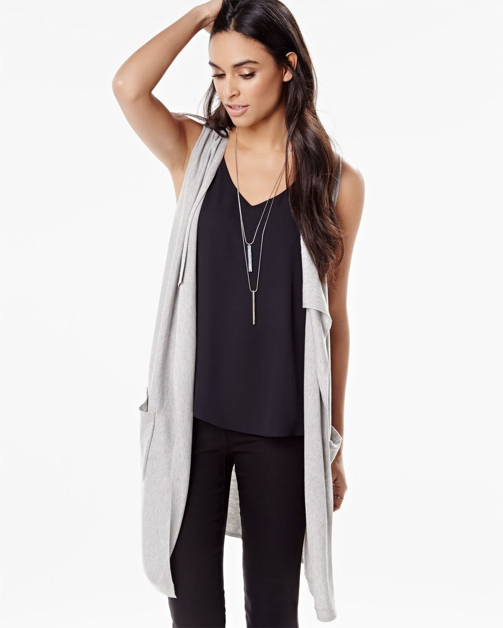 97028690220b81 This lightweight and versatile sleeveless cardigan is great for layering.  Try pairing it with a long sleeve shirt