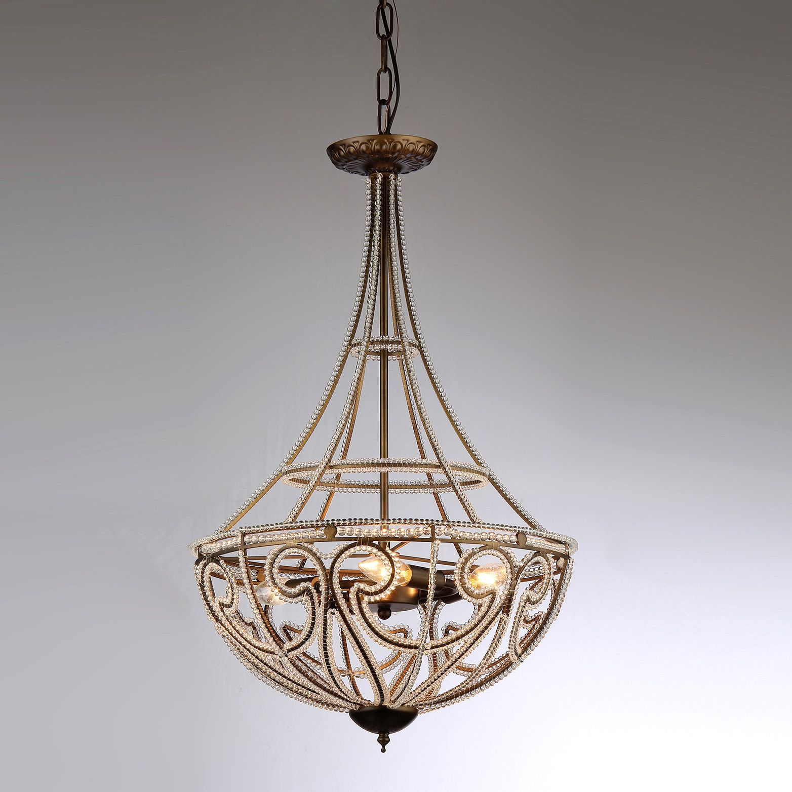 The antique bronze finish of this hercules scale chandelier provides lights the antique bronze arubaitofo Images