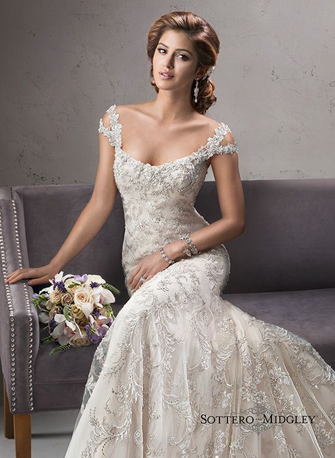064cd9f545 Exquisite beaded embroidered lace on tulle drapes over satin in this  stunning fit and flare gown