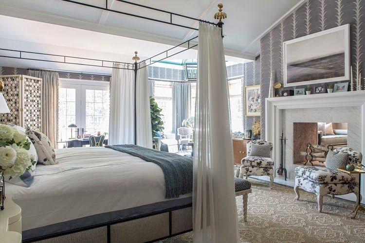 hamptons bedroom with a canopy bed marble fireplace and grape vine wallpaper - Marble Canopy Decor