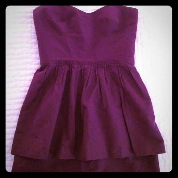 J.Crew strapless peplum purple short dress, size 6 Cute cotton blend strapless dress, purple plum color. Falls above knee. Flattering peplum style with pleating at waist. Back zip. Purchased new from JCrew a few years ago and worn a few times and in great condition. J. Crew Dresses