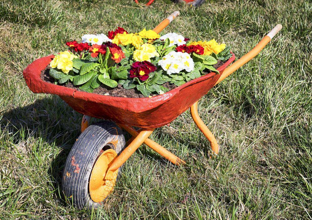 27 Wheelbarrow Flower Planter Ideas For Your Yard Wheelbarrow