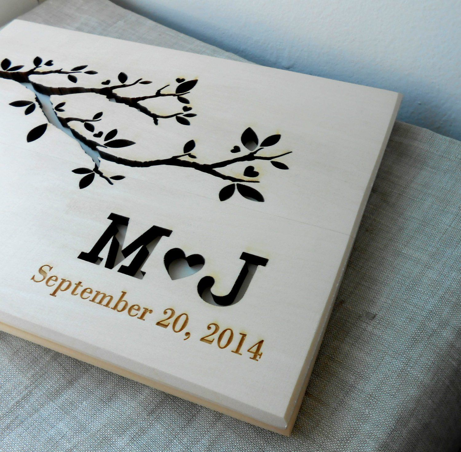 "Wedding guest book, rustic guest book, wooden wedding guest book album, personalized custom laser engraved guest book. Wooden wedding guest book. Rustic wedding sign in album. Size: 5,75"" x 8,25"" (14,6 cm x 21 cm) A5. Contains 30 sheets of light tan 80g/m2 paper. You can choose the color of the first page - the one you can see through the cut outs. Please write the names and date in the personalization section and also write the color of the first page.*************** Our production time..."