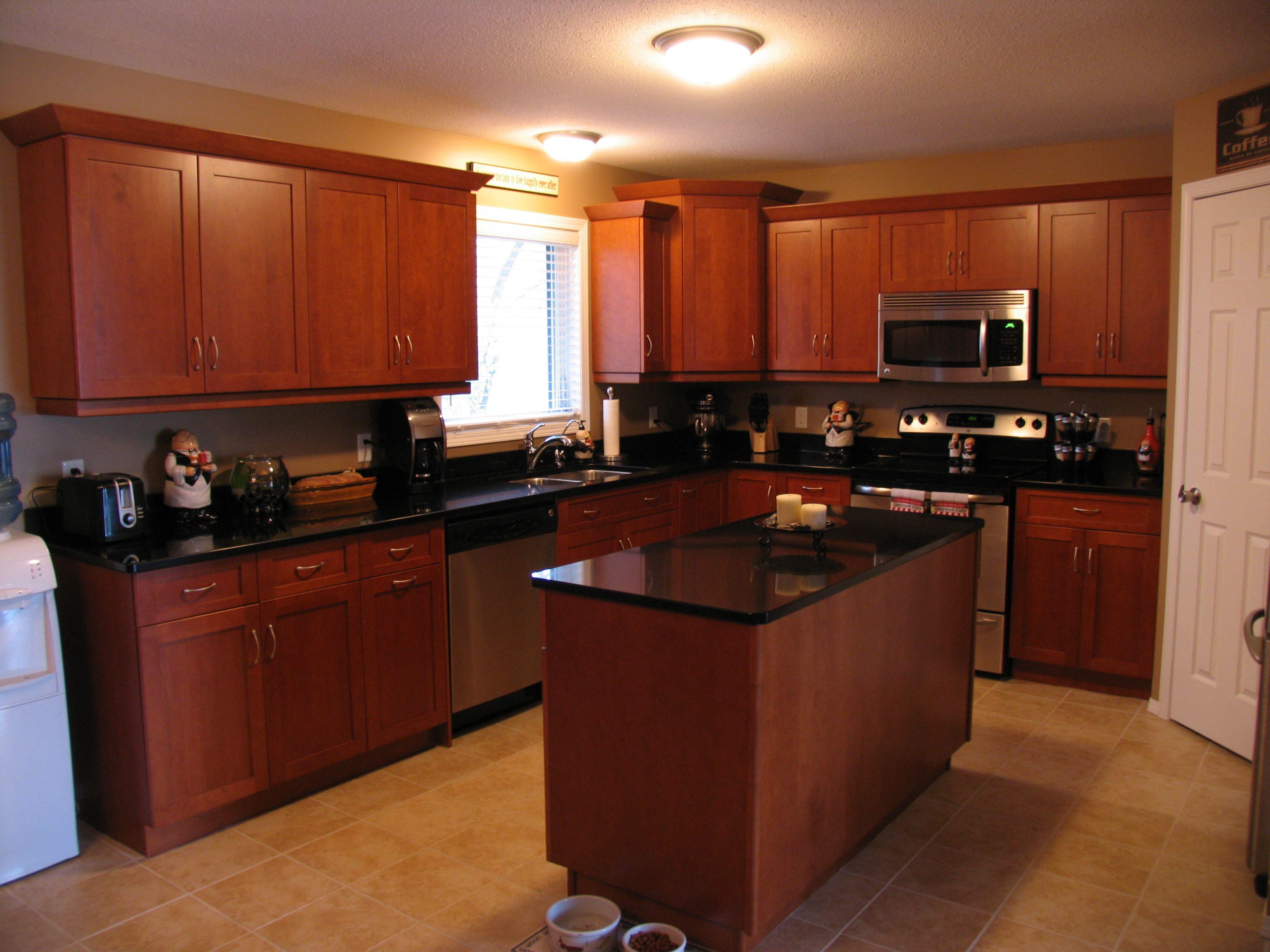 Cabinets: Maple - Honey Maple / Countertop: Cambria Quartz ... on Maple Kitchen Cabinets With Black Countertops  id=64844