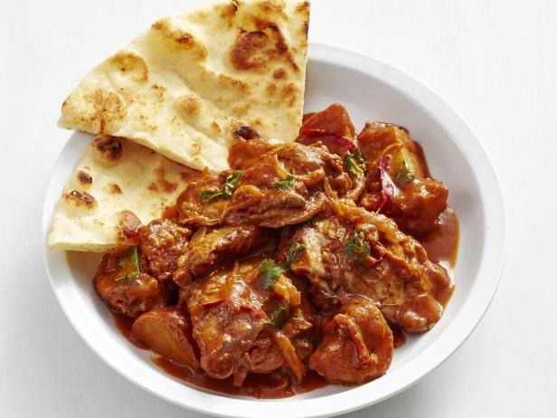 Recipe of the Day: Slow-Cooker Indian Butter Chicken Nestled in a butter-spiked, garam masala-spiced tomato sauce, boneless chicken thighs become a rich, comforting dinner after hours of low and slow cooking.The recipe's final step is stirring a little cream for a swirl of added richness.
