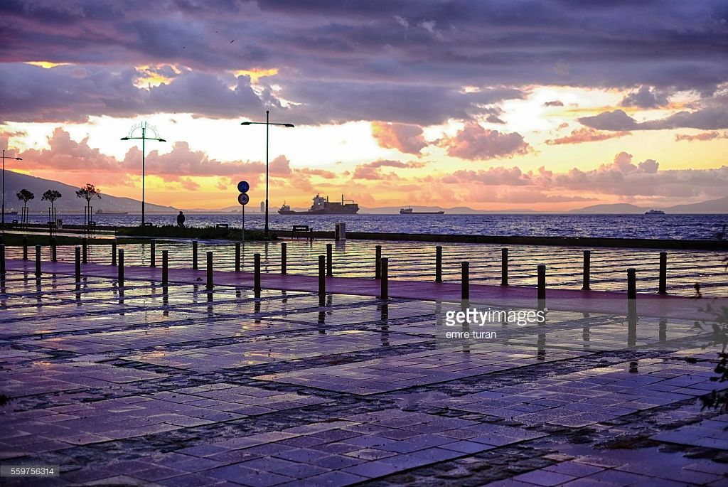as the sun sets above izmir bay on a rainy ,cloudy winter day,this purple colored scenery is created.sunsets above izmir bay are always picturesque.