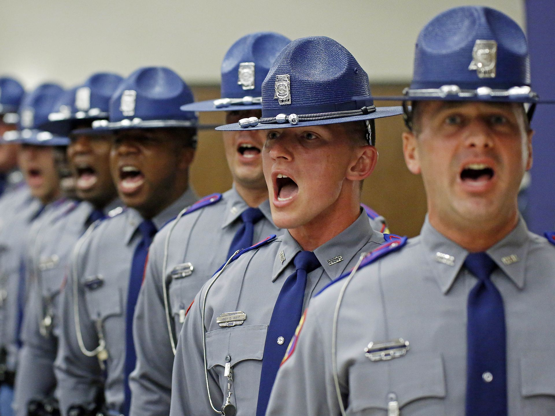 Troopers call out the Cadet's Creed during the commencement ceremony