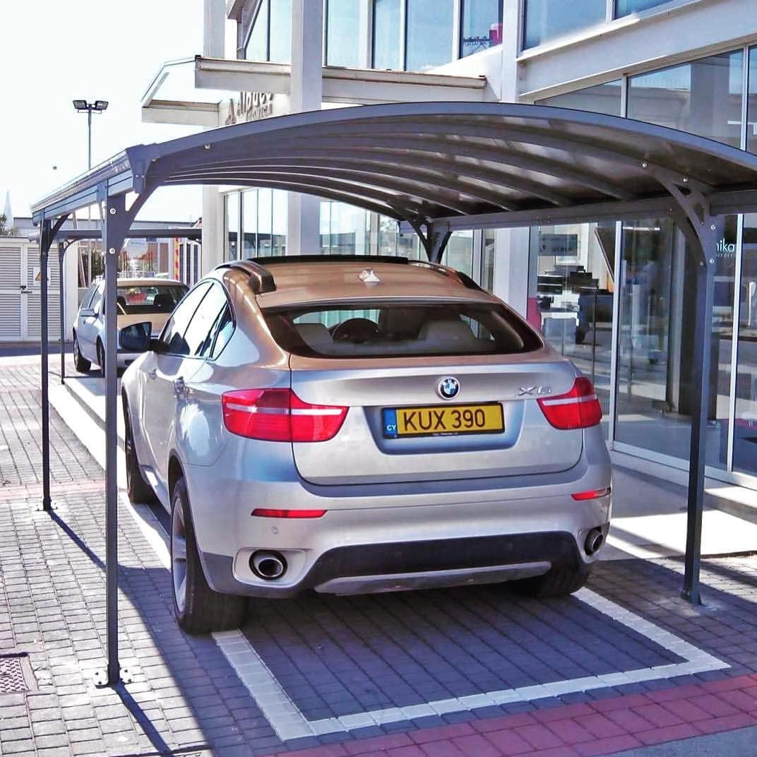 Vitoria 5000 Carport Can Be Easily Installed On A Solid Foundation In This Case A Brick Pavement Outside An Office Building In Cyprus Naves Dvor