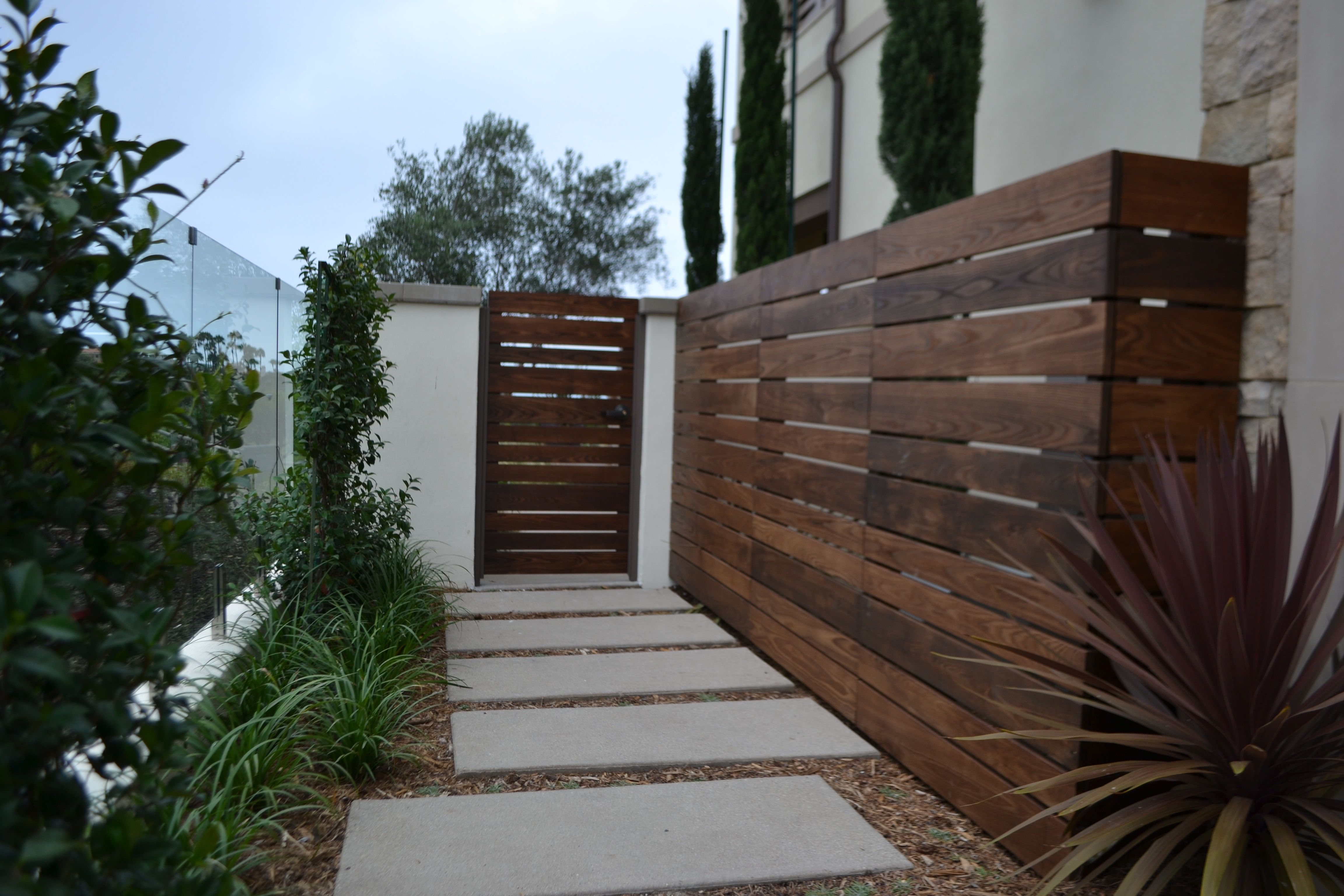 This House Needed Modern Fencing And A Courtyard Gate To Complete Their Front Yard We Custom Designed And Instal Front Courtyard Fence Design Modern Courtyard