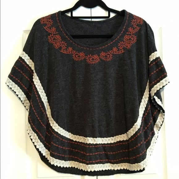 •PRICE DROP• Embroidered Sweater Cape Beautiful charcoal gray cape with burnt orange embroidered neckline and cream crochet detail! Has actual sleeves as shown in photo 3. Excellent condition. Because of it loose, flowy nature it will fit both S and M. No tag, I cut it out because it was itchy. *NOT ANTHRO* Anthropologie Sweaters Shrugs & Ponchos