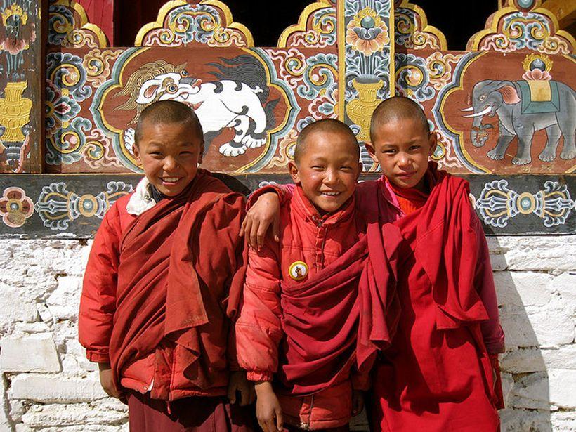...friendship - a language everyone understands...  Apprentice monks,  Bhutan.