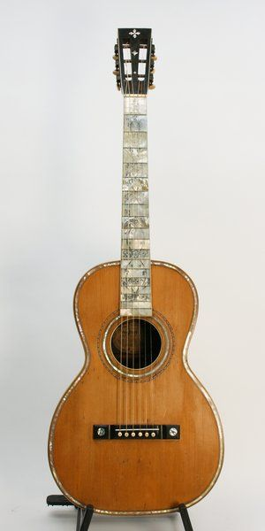 This is a very fancy, early parlor guitar approximately the size of