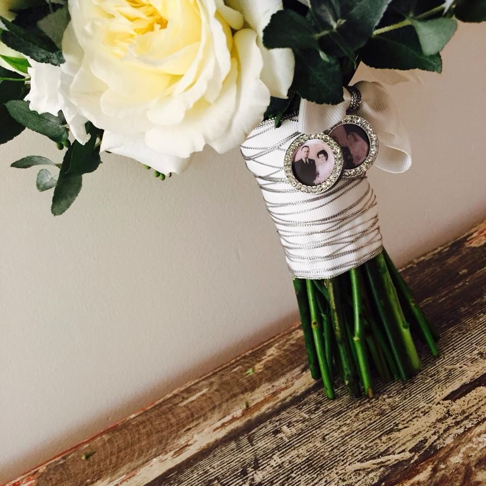 Bouquet Detail With Loved Ones In Tiny Frames Wedding Flowers And